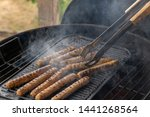 cooking sausages on the... | Shutterstock . vector #1441268564