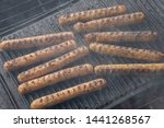 cooking sausages on the... | Shutterstock . vector #1441268567