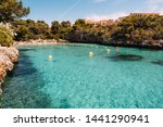 Panoramic view of turquoise water in Cala Ferrera in a sunny day, Cala D