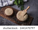White Sesame Seeds In A Wooden...