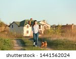 Stock photo young woman walking her adorable brussels griffon dogs outdoors 1441562024