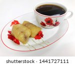 Stock photo bananas with sticky rice or khao tom mat or khao tom pad and hot americano coffee cup khao tom mat 1441727111