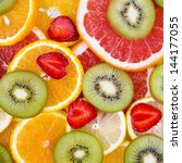 sliced fruits background | Shutterstock . vector #144177055