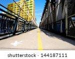 Walkway with fenced on the Manhattan Bridge in New York - stock photo
