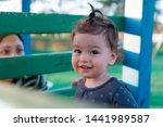 happy kid on kids playground... | Shutterstock . vector #1441989587