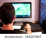 Young Man Playing Computer Gam...