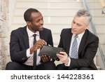 two businesspeople sitting on... | Shutterstock . vector #144228361