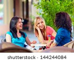 happy friends talking in summer ... | Shutterstock . vector #144244084