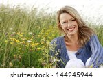 happy woman with a flower... | Shutterstock . vector #144245944
