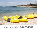 yellow kayaks at the beach | Shutterstock . vector #144258301