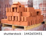 Red Clay Bricks Are Stacked On...