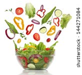 falling fresh vegetables.... | Shutterstock . vector #144271084