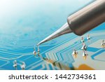 Small photo of Soldering of electronic circuit board with electronic components. Soldering station. Engineers repair circuit board with soldering iron.