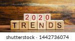 Small photo of Wooden blocks with the word Trends 2020. Main trend of changing something. Popular and relevant topics. New ideological trends of fashion. Recent and latest trend. Evaluation methods. Fashionable