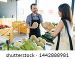 smiling mid adult grocery... | Shutterstock . vector #1442888981