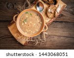 mushroom soup on a wooden table.... | Shutterstock . vector #1443068051