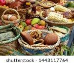 The set of traditional dishes of Ecuador, Cuenca: tortillas de trigo, maiz or morocho, cuy asado (guinea pig), humitas, tamales along with tomate de arbol,corn on cob, eggs,potatoes, bread and others