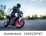 Biker Rides Motorcycle  Turns ...