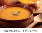 bowl with pumpkin soup and and... | Shutterstock . vector #144317491