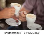 couple drinking coffee at cafe... | Shutterstock . vector #144320569