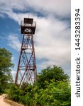 Small photo of Old rusty watchtower at the austrian hungarian border, a remain from the Cold war and the Iron Curtain