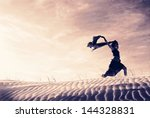 silhouette of a woman holding a ... | Shutterstock . vector #144328831