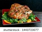 pernil pork roast garnished...   Shutterstock . vector #1443723077