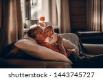 Small photo of Grandmother is kissing her grand daughter