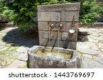 Stone Fountain With Two Iron...