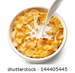pouring milk into bowl of corn... | Shutterstock . vector #144405445
