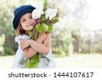 Cute Little Girl Holding A...