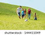 active happy family playing... | Shutterstock . vector #144411049