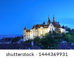 Skyline of Neuchatel, Switzerland featuring the Neuchatel Castle and the old town at night.