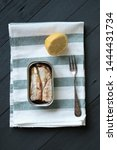 Stock photo can of sardines on kitchen towel lemon and fork 1444431734