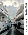 yachts docked side by side... | Shutterstock . vector #1444466204