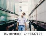 handsome young man in empty...   Shutterstock . vector #1444537874