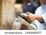 worker scanning package in... | Shutterstock . vector #144468547