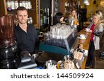 portrait of male bartender with ... | Shutterstock . vector #144509924