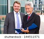two business men partner... | Shutterstock . vector #144511571