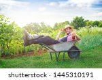 Funny Young Farmer Lying In...