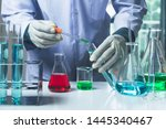 Small photo of Researcher with glass laboratory chemical test tubes with liquid for analytical , medical, pharmaceutical and scientific research concept.