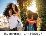 excited young women enjoying... | Shutterstock . vector #1445400827