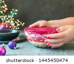 Stock photo woman hands with layered salad herring under a fur coat on festive table traditional russian salad 1445450474
