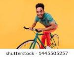 active african guy in green t... | Shutterstock . vector #1445505257
