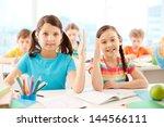 portrait of two diligent girls... | Shutterstock . vector #144566111