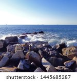 surf at rock beach at the small ... | Shutterstock . vector #1445685287