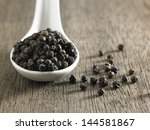 Spoon Full Of  Black Peppercorn