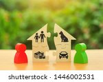 Small photo of Two human figures divide the house among themselves. Divorce concept. Execution of the posthumous will. Disputes over division process of real estate and property between former spouses, relatives.