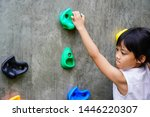 Little Girl Hanging On Holds O...