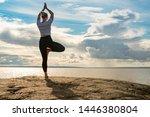 Woman Practicing Yoga ...
